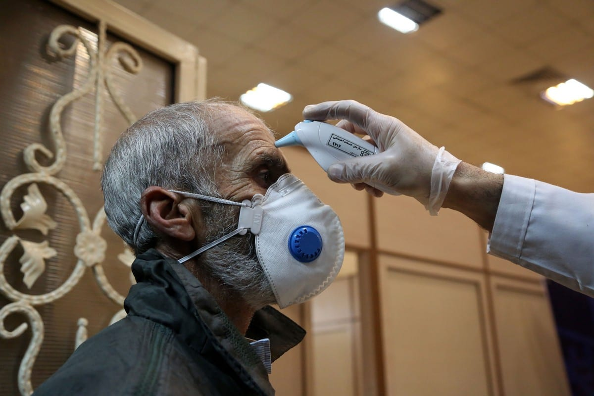 A man gets his temperature checked as a precaution against coronavirus (Covid-19) on 15 March 2020 [Fatemeh Bahrami/Anadolu Agency]