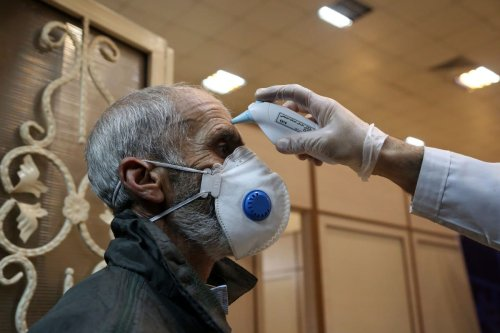 A man gets his temperature checked as a precaution against coronavirus (Covid-19) on 15 March 2020 [Fatemeh Bahrami/Anadolu Agency]