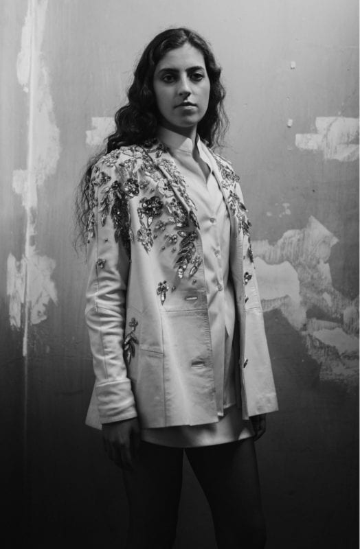 An image from the 2200 show, A jacket made from white vintage leather and embellished with pieces of a 1980s beaded dress. Both vintage pieces were donated in Beirut. Photo: Tamara Sade