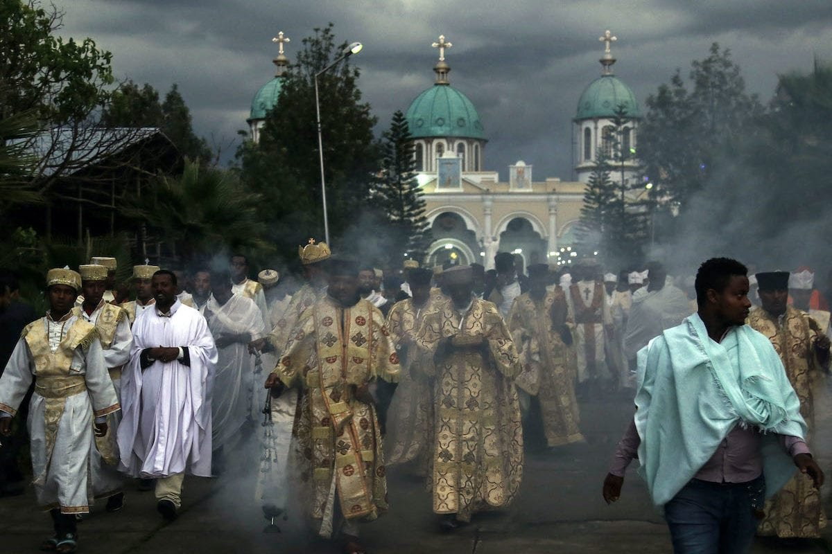 Ethiopian Orthodox Christians who gathered at Bole Medehanialem Church walk and pray for the immediate disappearance of coronavirus (Covid-19) pandemic, the end of death and the recovery of patients in Addis Ababa, Ethiopia on 24 March 2020. [Minasse Wondimu Hailu - Anadolu Agency]