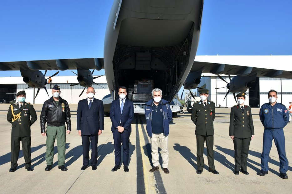 Italian Foreign Minister Luigi Di Maio (C), Italian Air Force Chief of Staff Lieutenant General Enzo Vecciarelli (2nd L) and Turkish Ambassador to Rome Murat Salim Esenli (3rd L) wait in the airbase as a Turkish military aircraft carrying medical aid arrives at Pratica di Mare Air Base on April 1, 2020 in Rome, Italy, one of the countries in Europe most affected by the novel coronavirus. Turkey sends medical aid to Italy and Spain to support the fight against coronavirus (COVID-19) pandemic. ( Barış Seçkin - Anadolu Agency )