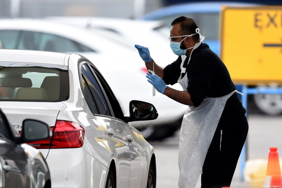 NHS workers check people at a coronavirus (COVID-19) drive-through testing station set up at the Wembley IKEA store for NHS staff on April 1, 2020 in London, United Kingdom. The Coronavirus (COVID-19) pandemic has spread to many countries across the world, claiming over 40,000 lives and infecting hundreds of thousands more. [Kate Green - Anadolu Agency]