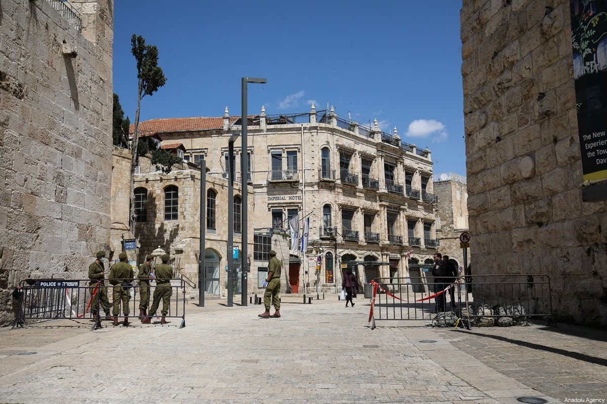A view of deserted Omar Ibn al-Hattab Square in East Jerusalem, on 3 April, 2020 [Mostafa Alkharouf/Anadolu Agency]