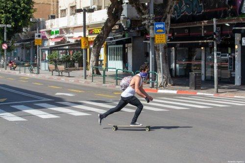 A man is seen on an empty road after precautions against coronavirus (Covid-19) are taken in Bnei Brak, Israel on April 3, 2020 [Nir Keidar / Anadolu Agency]