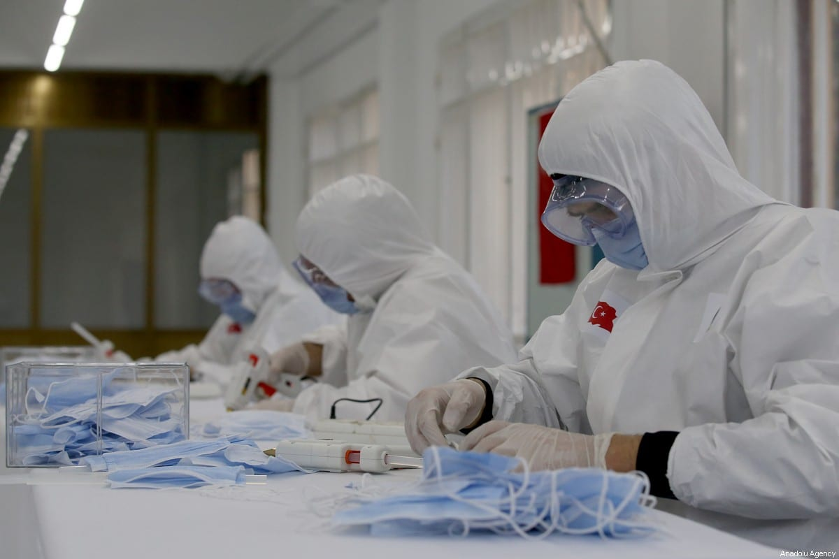 Workers seen during the production of protective face masks against the spread of novel coronavirus (COVID-19) pandemic at Mechanical and Chemical Industry Corporation's Mamak facility in Ankara, Turkey on April 2, 2020 [Raşit Aydoğan / Anadolu Agency]