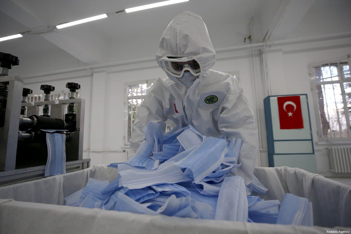 Personnels make production of protective face masks against the spread of novel coronavirus (COVID-19) pandemic at Mechanical and Chemical Industry Corporation's Mamak facility in Ankara, Turkey on April 2, 2020 [Raşit Aydoğan - Anadolu Agency]