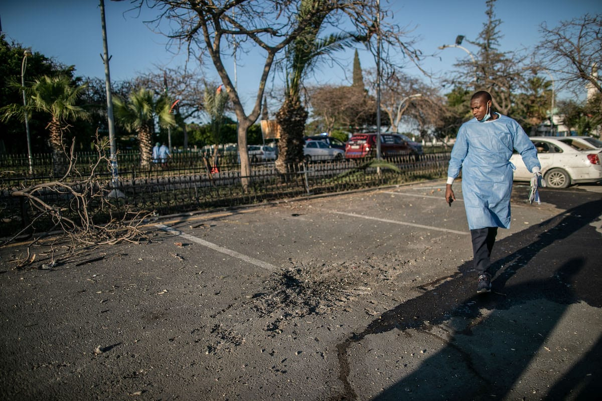 A doctor inspects the outside of the hospital after Haftar forces' rocket attacks hit the al-Hadra Hospital, which has many patients with chronic illnesses and especially coronavirus (COVID-19) , in Tripoli, Libya on 5 April 2020. [Amru Salahuddien - Anadolu Agency]