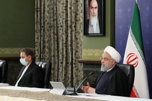 Iranian President Hassan Rouhani (R) speaks on the fall in oil prices due to the coronavirus (COVID-19) pandemic during a cabinet meeting in Tehran, Iran on 22 April 2020. [Presidency Of Iran / Handout - Anadolu Agency]