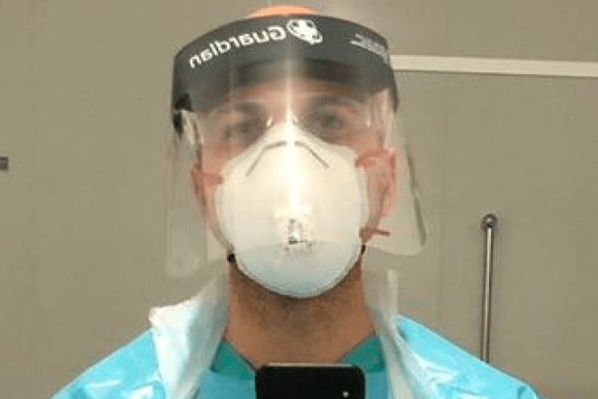 Awardwinning film maker Hassan Akkad poses in PPE gear after he began work as a cleaner in East London at Whipps Cross hospital [Twitter/Hassan Akkad]