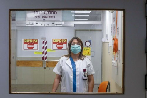 A Palestinian doctor is seen at the head of the COVID-19 clinic at the Rambam Hospital in Haifa on 16 April 2020 [AHMAD GHARABLI/AFP/Getty Images]