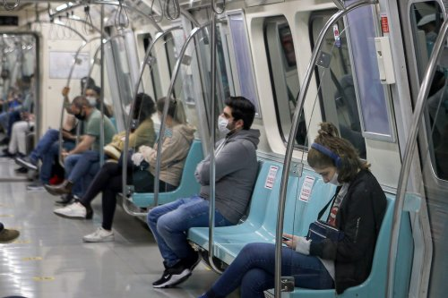 Passengers wear face masks as a precaution against coronavirus (Covid-19) in Istanbul, Turkey on 11 May 2020 [Mehmet Eser/Anadolu Agency]