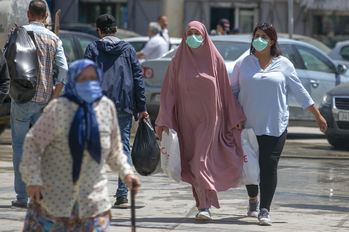 People wearing masks line up in front of stores due to the coronavirus (COVID-19) pandemic in Tunis, Tunisia on 11 May 2020 [Yassine Gaidi/Anadolu Agency]