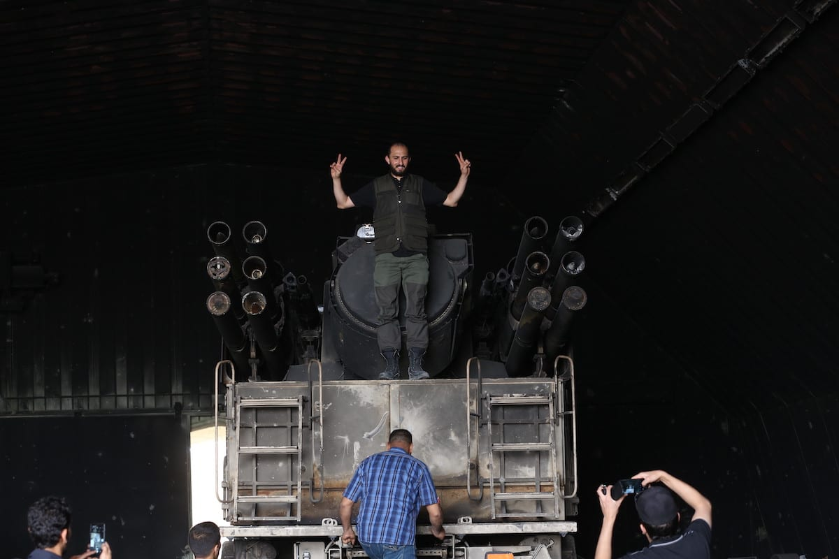Member of the GNA army poses for a photo over a Pantsir air defense system after Libya's army retook Al-Watiya airbase occupied by Khalifa Haftar's LNA militias in Tripoli, Libya on May 18, 2020. The move came after the Libyan army destroyed a total of three Russian-made Pantsir-type air defense systems of Haftar supplied by the United Arab Emirates (UAE) [Hazem Turkia / Anadolu Agency]