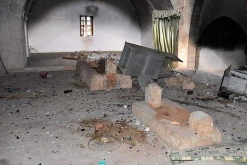The tomb of Umayyad Caliph Umar Ibn Abdul Aziz was burnt and destroyed by militias in Syria 28 May 2020 [Sa'na Agency/Twitter]
