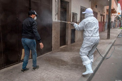 A Moroccan health ministry worker disinfects a street in the capital Rabat on April 9, 2020 during the coronavirus COVID-19 pandemic crisis. (Photo by FADEL SENNA / AFP) (Photo by FADEL SENNA/AFP via Getty Images)