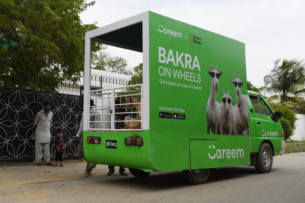 Careem's cab service 'Bakra on wheels' is seen parked outside customer's house during the delivery of goats ahead of the Muslim festival Eid al-Adha, in Karachi, Pakistan's [RIZWAN TABASSUM/AFP via Getty Images]