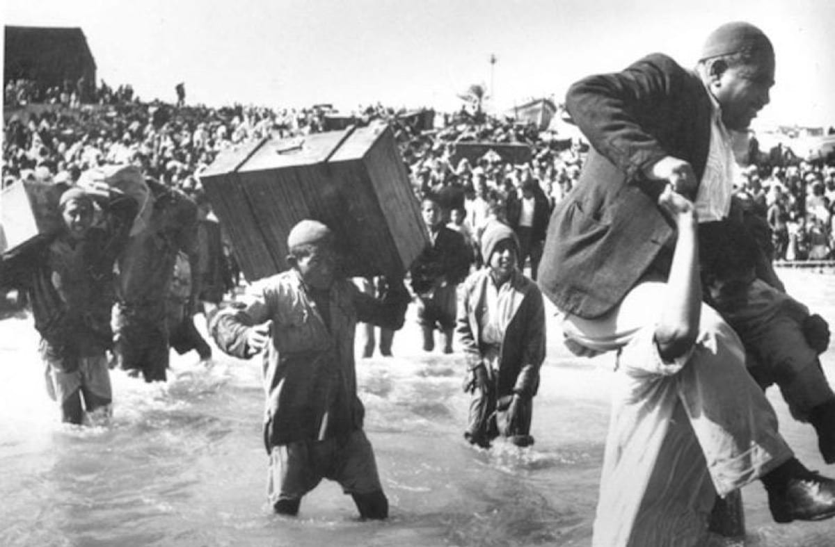 Palestinians can be seen fleeing their homes during the 1948 Nakba, also known as 'The Great Catastrophe'