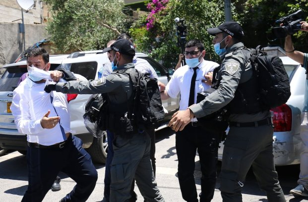 Palestinian demonstrators are being detained during clashes between the Israeli police and the demonstrators in a demonstration in support of Sheikh Ekrema Sabri, the grand imam of Al-Aqsa Mosque, in Jerusalem on 3 June 2020. [Mostafa Alkharouf - Anadolu Agency]