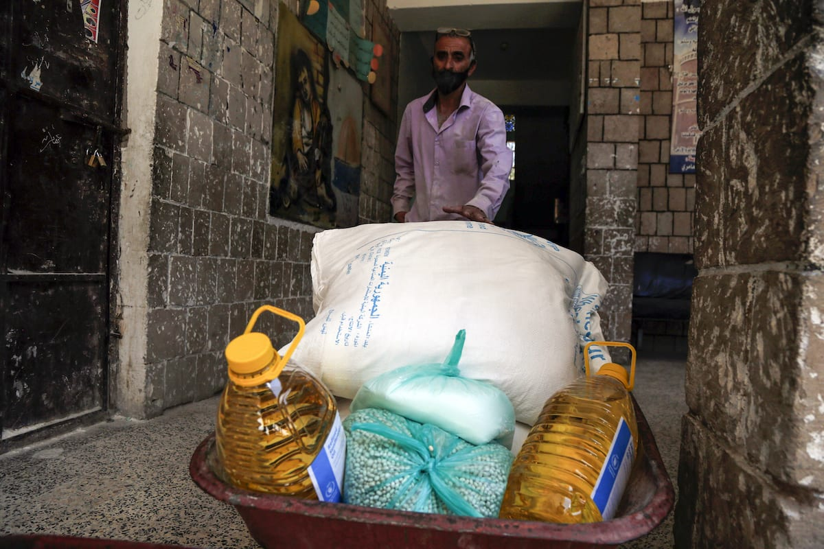 Food aid sent by World Food Program (WFP) is being distributed to needy people in Yemeni capital city Sanaa on 3 June, 2020 [Mohammed Hamoud/Anadolu Agency]