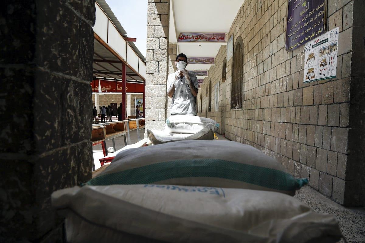 SANAA, YEMEN - JUNE 03: Food aid sent by World Food Program (WFP) is being distributed to needy people in Yemeni capital city Sanaa on June 03, 2020. United Nations World Food Program (WFP) sent food aid to the country to support the struggle against the novel coronavirus (Covid-19) pandemic. ( Mohammed Hamoud - Anadolu Agency )