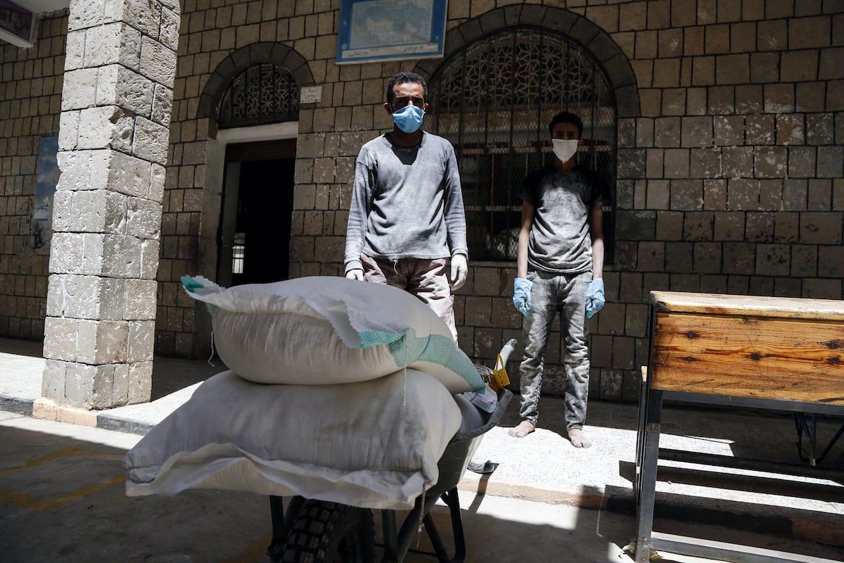 Food aid sent by World Food Program (WFP) is being distributed to needy people in Yemeni capital city Sanaa on June 03, 2020 [Mohammed Hamoud / Anadolu Agency]
