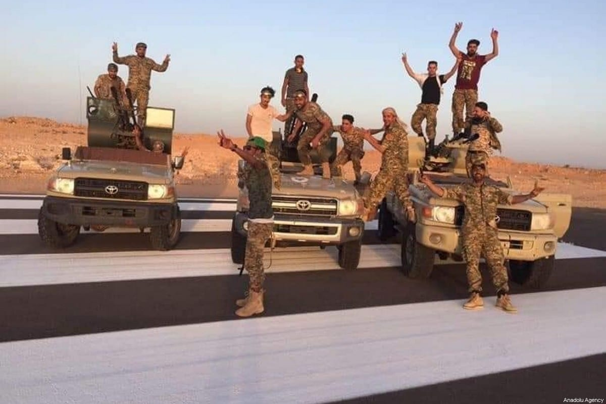 Members of The Libyan Army celebrate after they liberated the strategic Bani Waled city, where warlord Khalifa Haftar left in Libya on 5 June 2020. [VOLCANO OF RAGE OPERATION - Anadolu Agency]