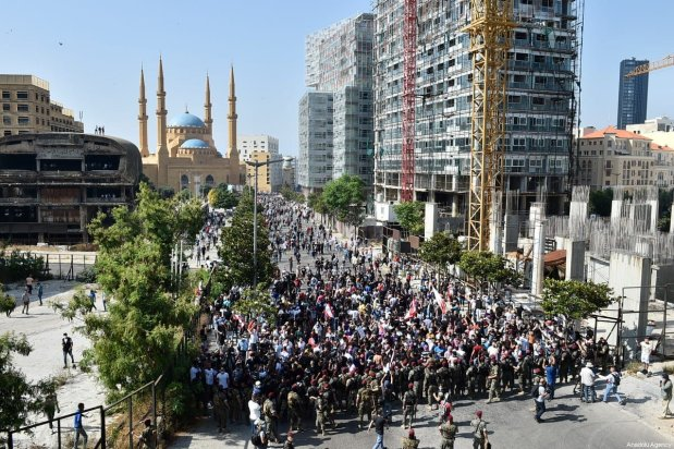 Thousands of people gather at Martyrs' Square during a demonstration to protest against economic crisis and high cost of living, on June 06, 2020 in Beirut, Lebanon [Hussam Chbaro / Anadolu Agency]