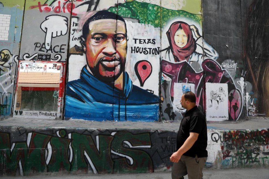 Portrait of George Floyd, a 46-year-old unarmed black man who was killed after a police officer knelt on his neck for nearly nine minutes, is painted on Israel's separation wall in the West Bank town of Bethlehem on June 8, 2020 [Wisam Hashlamoun - Anadolu Agency]