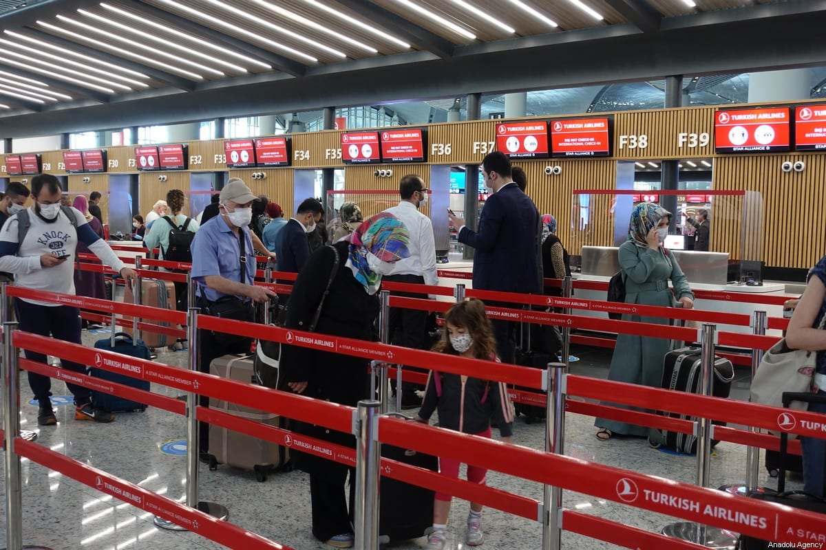 Passengers are seen at Istanbul Airport after partial resumption of international flights, which have been suspended for 2 months, in Istanbul, Turkey on 11 June 2020 [Kenan Irtak - Anadolu Agency]