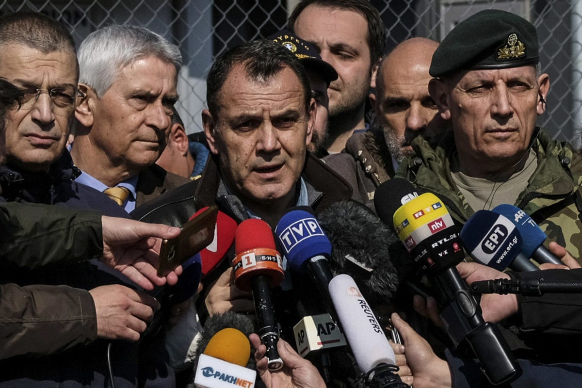 Greek Defence Minister Nikos Panagiotopoulos takes questions from reporters after touring the Greek-Turkish border in Kastanies on March 1, 2020 in Kastanies, Turkey [Byron Smith / Getty Images]