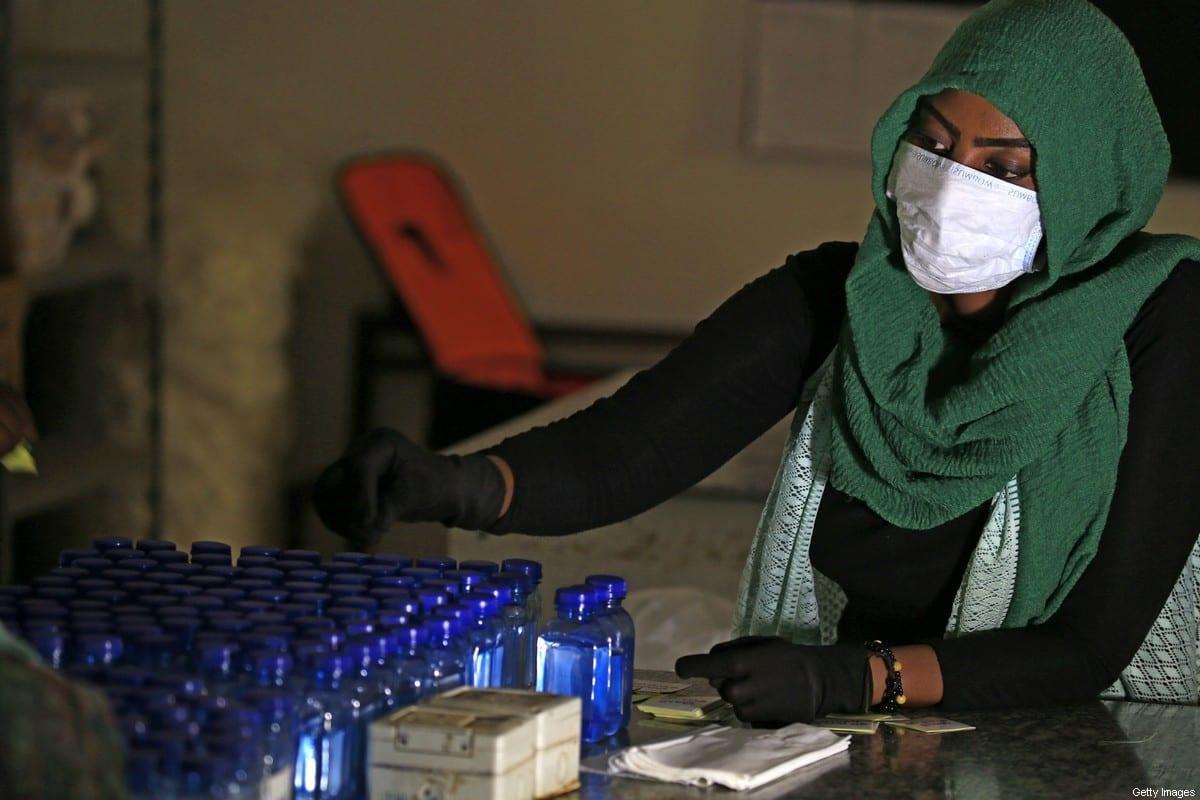 Sudanese medical laboratory students prepare sterilisers to combat the spread of the coronavirus COVID-19 n Khartoum, Sudan on 14 April 2020 [ASHRAF SHAZLY/AFP/Getty Images]