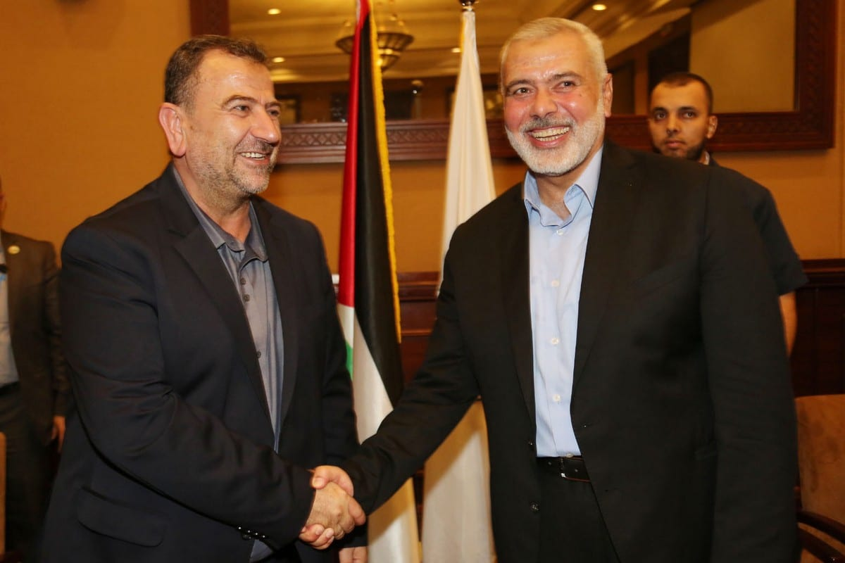 Palestinian Hamas Chief Ismail Haniyeh shakes hands with Hamas Deputy Chief Saleh al-Arouri, in Gaza City 2 August 2018 [Hamas Chief Media Office/ApaImages]
