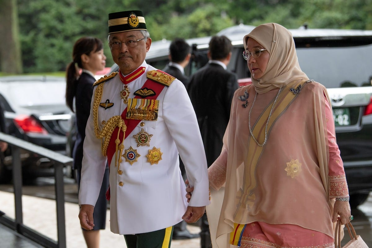 Malaysia's King Sultan Abdullah Sultan Ahmad Shah and Queen Tunku Azizah Aminah Maimunah on 22 October 2019 [CARL COURT/POOL/AFP/Getty Images]
