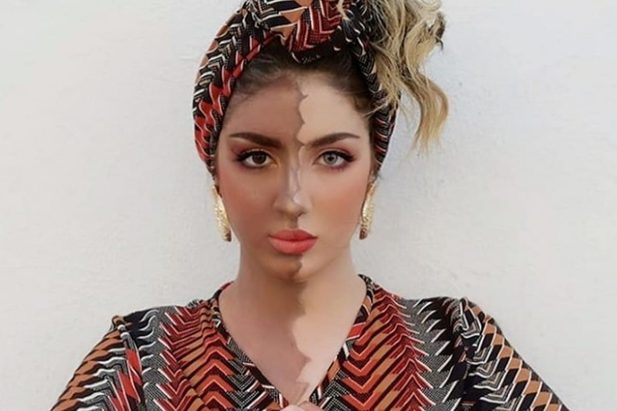 Algerian Souhila Ben Lachhab posted a photo on Instagram with half of her face and one hand coloured black, 3 June 2020 [souhilaofficial/Instagtam]