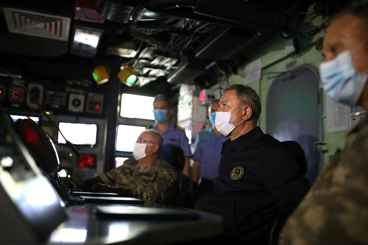 Turkish Defense Minister Hulusi Akar and Chief of General Staff Gen. Yasar Guler get information on works at Combat Operations Centre in TCG Giresun as they visit Turkish Naval Task Group's ship performing duty in the Central Mediterranean upon their arrival with a military helicopter from Mitiga Airport in Tripoli, Libya on 4 July 2020. [Arif Akdoğan - Anadolu Agency]