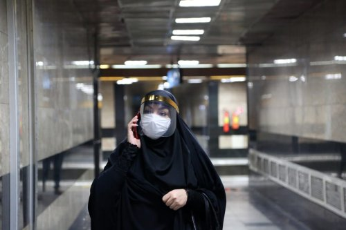 A woman wearing masks is seen at a subway after wearing face mask become mandatory in public transports in Tehran, Iran 15 June, 2020 [Fatemeh Bahrami/Anadolu Agency]