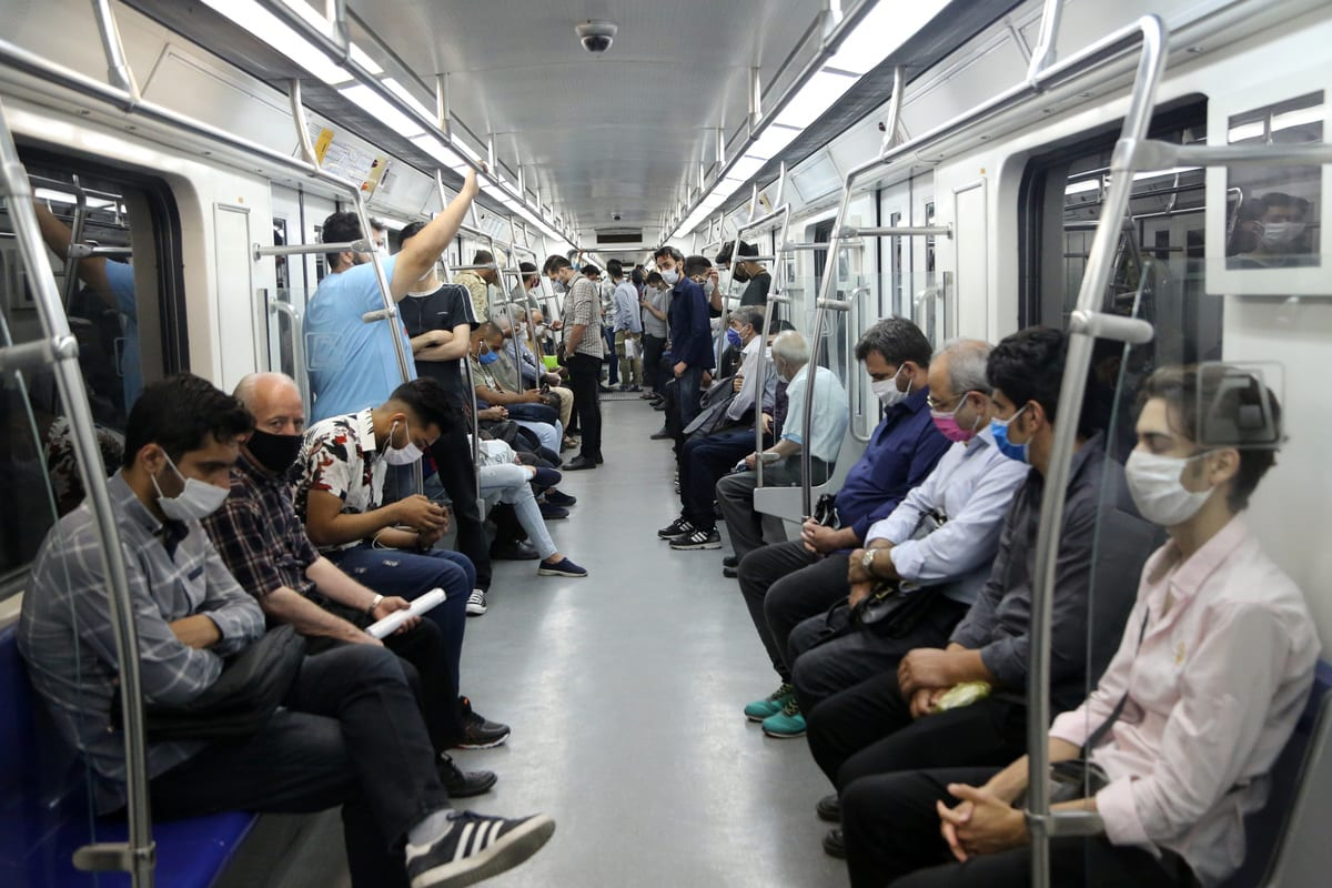 Citizens wearing masks are seen at a subway after wearing face mask become mandatory in public transports like metro and busses within the novel coronavirus (COVID-19) pandemic precautions in Tehran, Iran June 15, 2020. [Fatemeh Bahrami - Anadolu Agency]