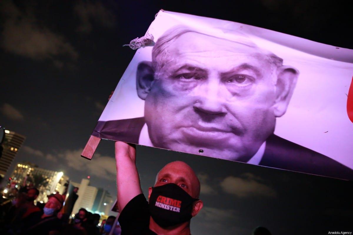 Israelis gather at a protest demanding Benjamin Netanyahu's resignation at the Rabin Square in Tel Aviv, Israel on July 18, 2020 [Daniel Bar-On / Anadolu Agency]