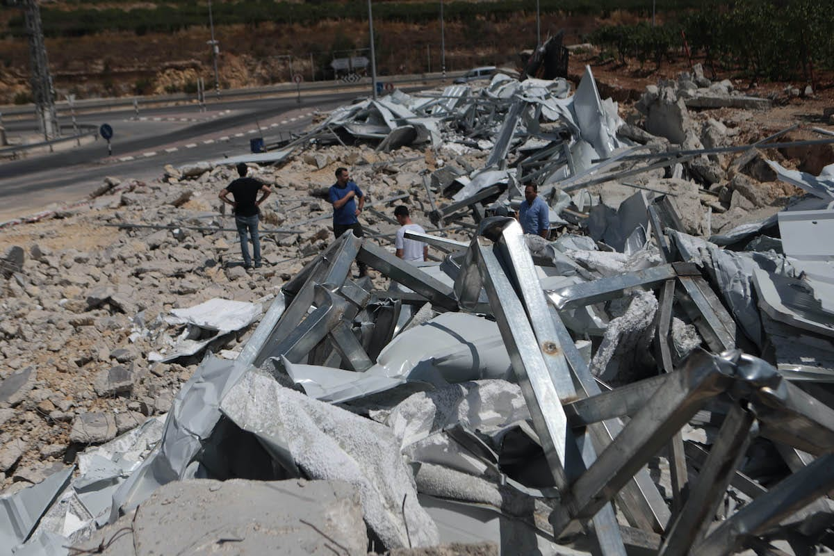 Palestinians inspect the debris of a quarantine center established within fighting against coronavirus (Covid-19) pandemic after Israeli soldiers demolished the single-story center on the grounds that it is unlicensed in Hebron, West Bank on July 21, 2020. ( Mamoun Wazwaz - Anadolu Agency )