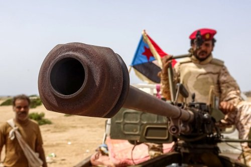 A fighter loyal to Yemen's separatist Southern Transitional Council (STC) holds the separatist flag in the southern Abyan province on 15 May 2020 [NABIL HASAN/AFP/Getty Images]