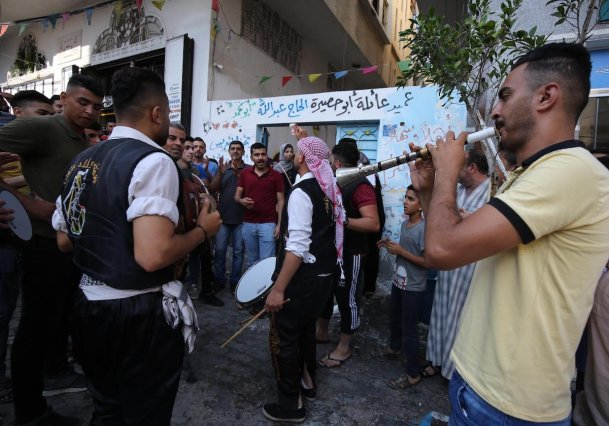 Students and families in Gaza celebrate their success in high school exams in Gaza on 11 July 2020 [Mohammed Asad/Middle East Monitor]