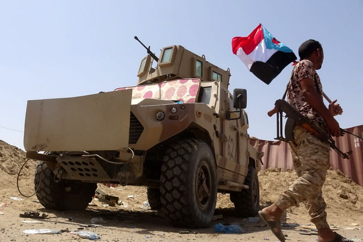 A fighter loyal to Yemen's separatist Southern Transitional Council (STC) holds the separatist flag in the southern Abyan province on May 18, 2020 [NABIL HASAN/AFP via Getty Images]