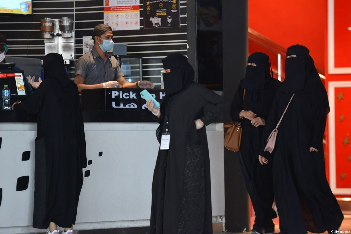 Women wait to pick up their orders from a restaurant in a shopping mall in the Saudi capital Riyadh on 4 June 2020, after it reopened following the easing of some restrictions put in place by the authorities in a bid to stem the spead of the novel coronavirus. [FAYEZ NURELDINE/AFP via Getty Images]