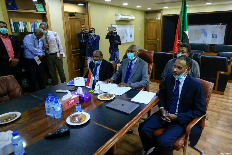Sudan's Minister of Irrigation and Water Resources Yasir Mohamed (C) takes part in a video meeting at the ministry in Khartoum on June 9, 2020, over the Grand Ethiopian Renaissance Dam. - Egypt's President Abdel Fattah al-Sisi strongly rebuked Ethiopia, accusing Addis Ababa of stalling negotiations over a mega-dam being built on the Nile and moving ahead with plans to start filling the reservoir before reaching a deal. The agreement signed between Egypt, Ethiopia and Sudan paved the way for diplomatic talks after Addis Ababa sparked tension when it began construction of the Grand Ethiopian Renaissance Dam nearly a decade ago. [ASHRAF SHAZLY/AFP via Getty Images]