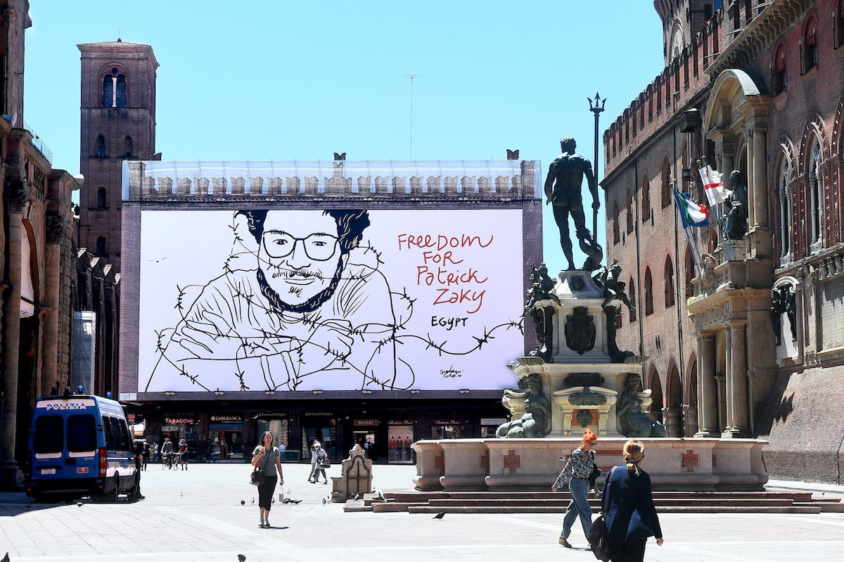 A big panel with the artwork by italian artist Gianluca Costantini claiming the freedom for Patrick Zaki, citizen of Bologna and student at University of Bologna who is detained in Egypt, is seen on the Palazzo Notai facade at Piazza Maggiore on 26 May 2020 in Bologna, Italy. [Roberto Serra - Iguana Press/Getty Images]