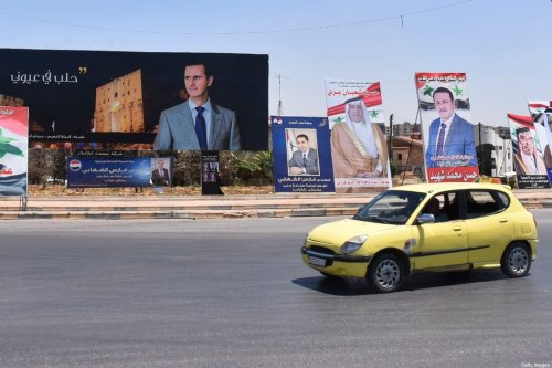 Campaign posters of candidates for the upcoming Syrian parliamentary election are displayed in the northern city of Aleppo, on July 15, 2020 [-/AFP via Getty Images]