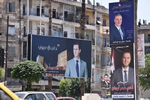Campaign posters of candidates for the upcoming Syrian parliamentary election are displayed in the northern city of Aleppo, on July 15, 2020. (Photo by - / AFP) (Photo by -/AFP via Getty Images)
