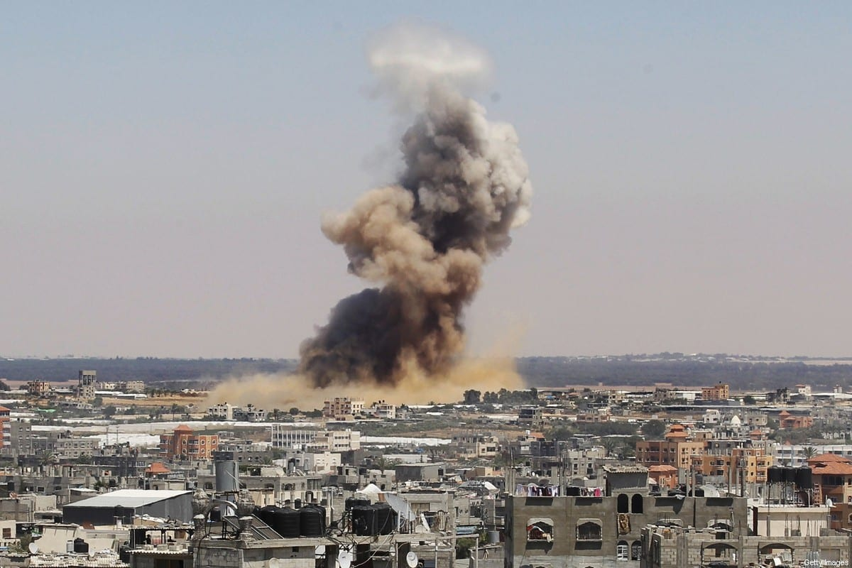 Smoke and dust rise following an Israeli air strike in Rafah, in the south of the Gaza Strip, on July 8, 2014 [SAID KHATIB/AFP via Getty Images]