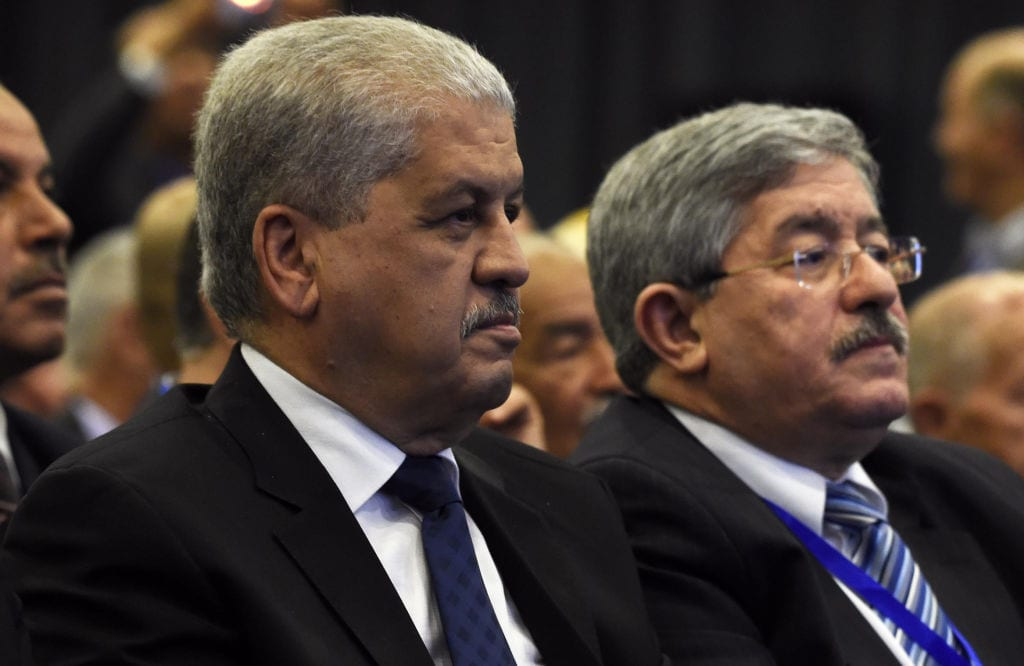 Algeria's former Prime Minister Abdelmalek Sellal (L) and Rally for National Democracy (RND)'s interim secretary general, Ahmed Ouyahia, attend an extraordinary meeting of the RND on 5 May, 2016, in Algiers [FAROUK BATICHE/AFP via Getty Images]