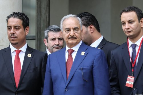 Libya Chief of Staff, Marshall Khalifa Haftar, whose rival Libyan National Army dominates the country's east, stands at the steps of the Elysee Palace with his delegation as they leave following the International conference on Libya in Paris on May 29, 2018. [LUDOVIC MARIN/AFP via Getty Images]